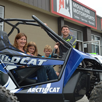 Kim and Aaron Bernasconi (with their kids Bella and Ben), owners of Mountain Motorsports and Golden Snowmobile Rentals in Golden, B.C.