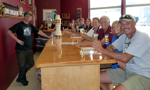 Visitors enjoy beer on tap at Mt. Begbie Brewing Co.'s current location.