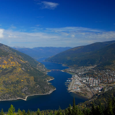 An aerial view of Nelson surrounded by the Selkirk Mountains and Kootenay Lake.