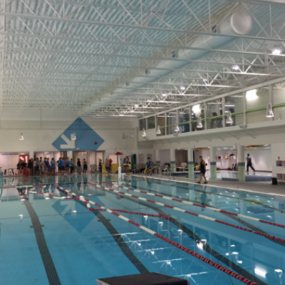 The renovated main pool, looking toward the new lifeguard room.