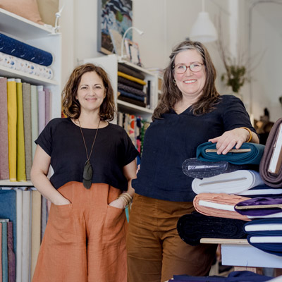Deborah Achleitner (L) and Sarah Albertson (R), co-owners of the Nelson Stitch Lab, standing in store.