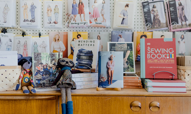 Display of patterns and sewing books.
