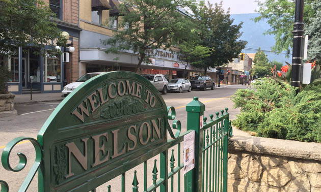 Nelson welcome sign and downtown Nelson.