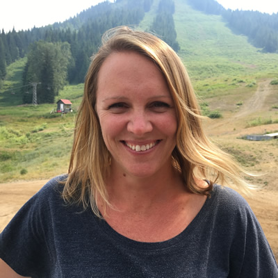 Nicole Briggs, the marketing and events manager at Red Mountain Resort In Rossland, B.C., stands for a moment at the bottom of the ski hill in August