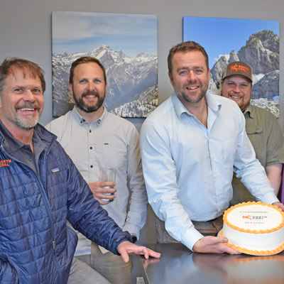 Group of North Coal employees celebrating and holding a cake.