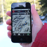 Photo of someone holding an iPhone displaying the new app upgrade to help improve avalanche forecasting