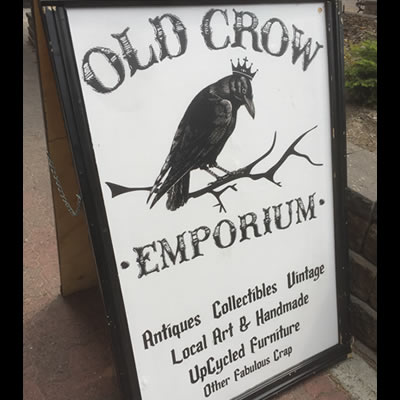 Sign for Old Crow Emporium and interior picture of shop.