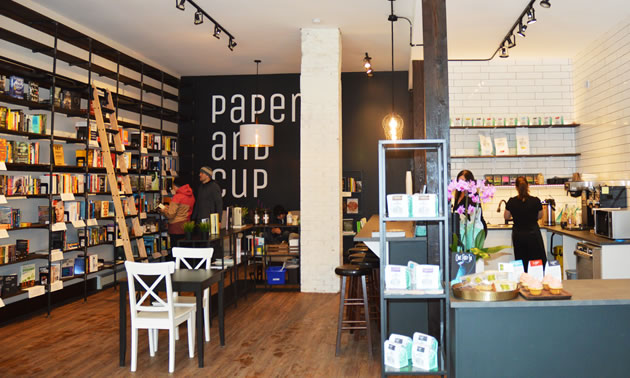 The interior of Paper and Cup includes shelves of books and a café that sells drinks and food.