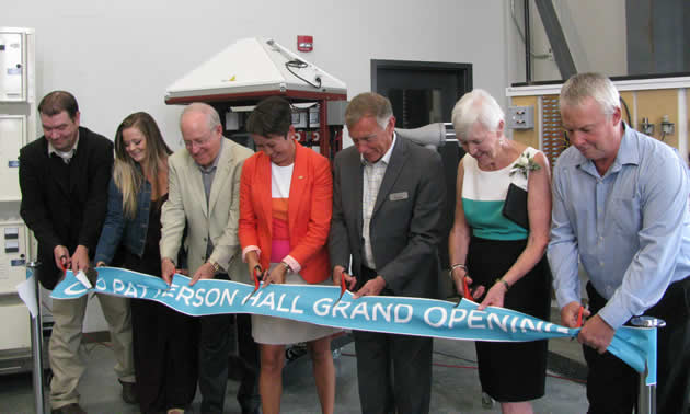 Cutting the ribbon at the grand opening of Patterson Hall were Jesse Nichols (COTR board of governors), Sarah Weech (COTR trades student), Rick Jensen (CBT), Melanie Mark (province of B.C.), David Hall (COTR), Nancy Eckstein (nee Patterson) and Larry Davey (Teck).
