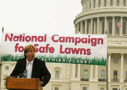 A man speaks from a podium at a rally