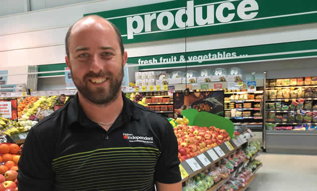 Brian Pealow, owner of Pealow's grocery store in Creston, in the store's colourful produce department