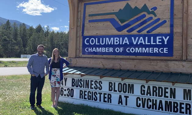 Executive director Pete Bourke and visitor centre supervisor Sarah Miller of the Columbia Valley Chamber of Commerce, beside the chamber sign on Highway 93/95