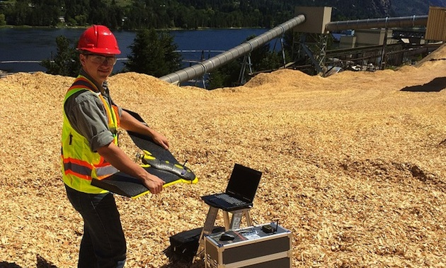 Peter LeCouffe, Operations Manager, shown holding the Fixed Wing Drone at the Celgar pulp mill in Castlegar BC.