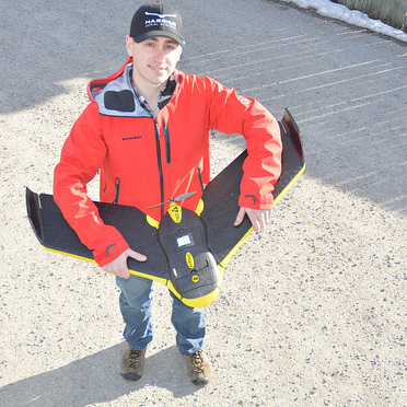 Peter LeCouffe, Operations Manager, at Harrier Aerial Surveys shows off a fixed wing drone.