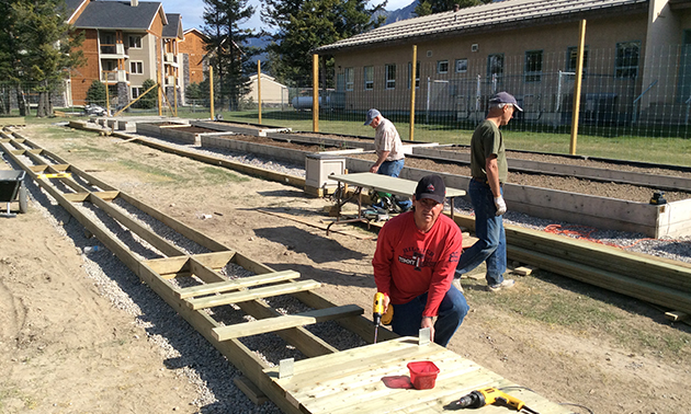 Volunteers build the raised planters for the Rotary Gardens in Radium Hot Springs.