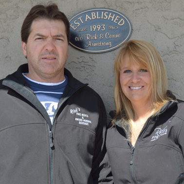 Couple stands outside a commercial building