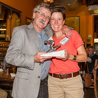 Christine Andison, President of Red Mountain Racers,  accepting the award from Bruce Goldsmid, BC Alpine's CEO.