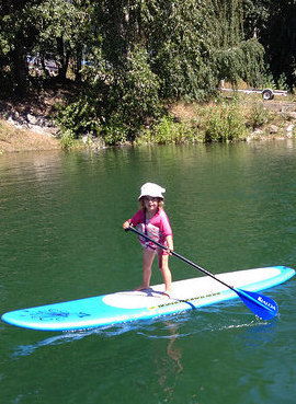 Raddison Ryman takes after her mom on a stand-up paddleboard.