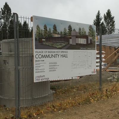 Sign on fence about the new Radium Community Hall.