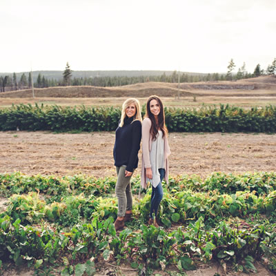 Natasha Benson (L) and Julie Taylor, owners of The Raw House, are standing in a field of beets.