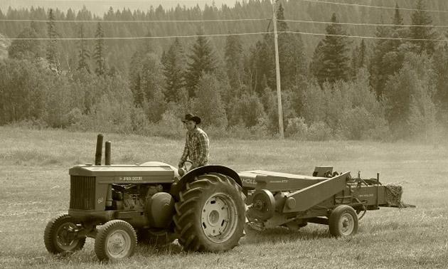 Raylen Tress on tractor.