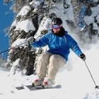 a skier skiing down a snowy mountain