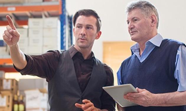 Two men talking together.