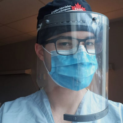Medical professional wearing face shield.