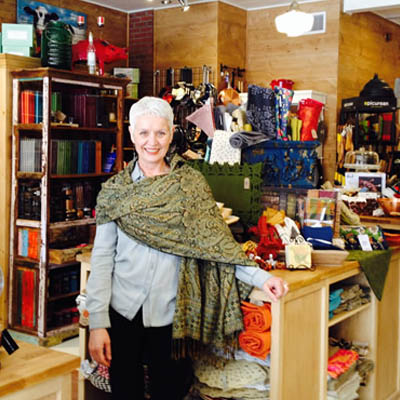 Robin Dixon standing in her shop, The Grater Good.