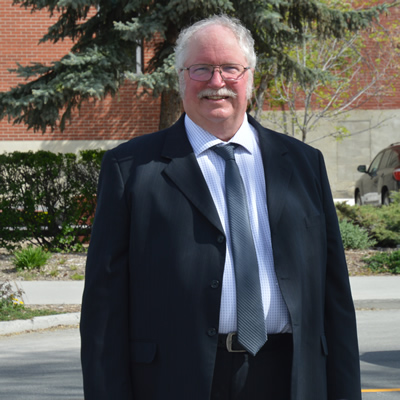Ron Fraser stands outside Cranbrook city hall
