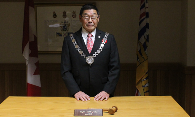Ron Toyota, mayor of Creston, wearing his chain of office