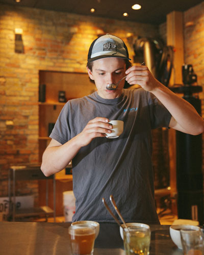 Keegan Street sampling coffee.