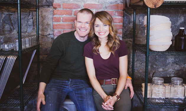 The two owners of The Purist Pantry are shown seated: Todd and Melinda Kopet.