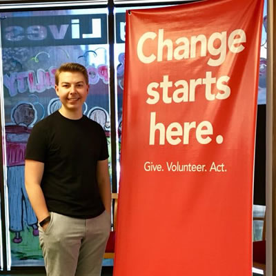 Event Associate Seamus Damstorm displays the United Way banner during a recent fundraising campaign.