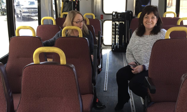 Susan Clovechok (right), executive director of the Columbia Valley Chamber of Commerce, checks out a coach that should soon be engaged to shuttle Columbia Valley residents between the valley and Calgary.