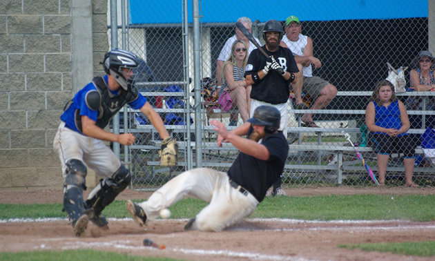 Ball player slides in at home plate