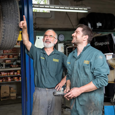 Employer and apprentice in mechanic's shop.