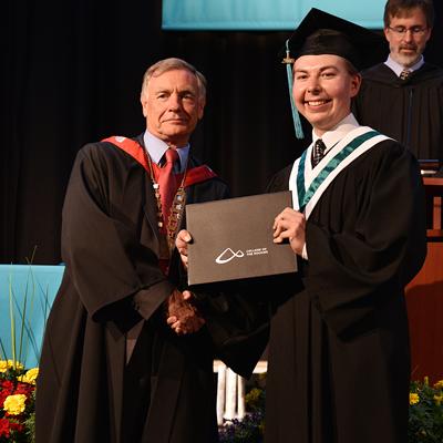 Seamus Damstrom accepting scholarship award.