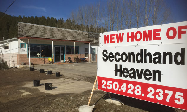 Sign advertising Secondhand Heaven's new location in Creston.
