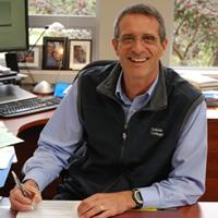 Selkirk College President Angus Graeme signs Transfer Agreement