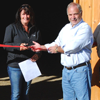 From left, Selkirk Saddle Club vice president Kelly Richards, secretary Tanya Secord, mayor David Raven and club president Hans Michel join in the ribbon cutting for the new indoor riding arena.