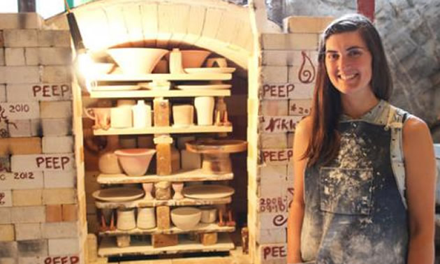 Selkirk College Kootenay Studio Arts student Kaeli Benoit stands by the gas-fired kiln which she used in the process of preparing her final pieces for the annual Year End Show & Sale.
