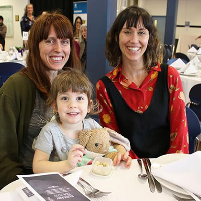 Meghan Stewart (right) with her daughter Ruby and life-long friend Amy Stewart at the annual Bursary Tea.