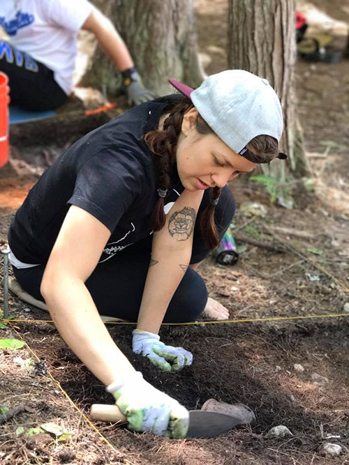 Selkirk College's Reyna Brown is a local student participating in Hamilton College's Slocan Narrows Archaeological Project alongside the Slocan River. Uncovering artifacts from Indigenous pit houses in the area is a valuable experience for the Anthropology enthusiast.