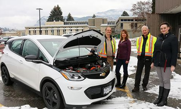 Members of the Selkirk College facilities team—(L-R) Mike Geisler, Melanie Perepolkin, Ron Zaitsoff and Pauline de Grandpre—check out the new Chevrolet Bolt which has been added to the college fleet.