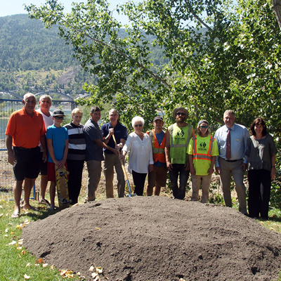 On a pretty summer day, Trail mayor Mike Martin and local stakeholders posed around a mound of soil to mark the groundbreaking for the Trail skate park.