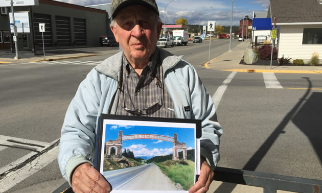 Picture of Skip Fennessy, holding picture of proposed Cranbrook arches.