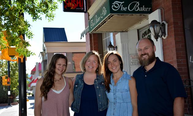 Greg Eaton, Tamara Mercandelli, Caitlin Berkhiem and Christel Hagn, outside Cranbrook's Historic Baker Hotel.