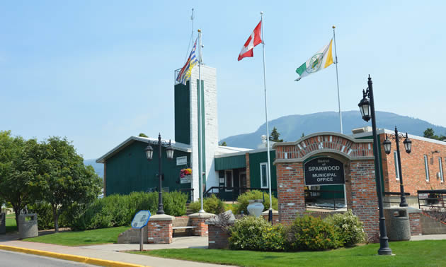 Flags fly over the Sparwood municipal building that is home to the District of Sparwood's administrative team