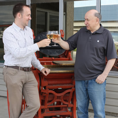 Stephen Wik (left) toasts to new beginnings with Don Wik. In early June, Stephen bought Don's 44-year old business Rocky Mountain Print Solutions and merged it with Murray's Office Plus.